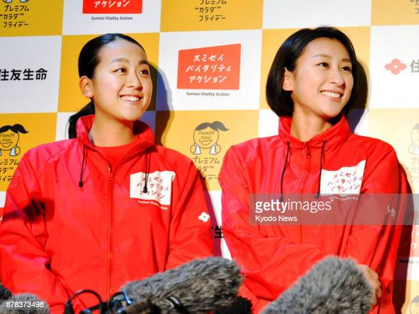 Vancouver Olympic silver medalist Mao Asada who recently retired from competitive figure skating and her elder sister Mai speak to reporters during...