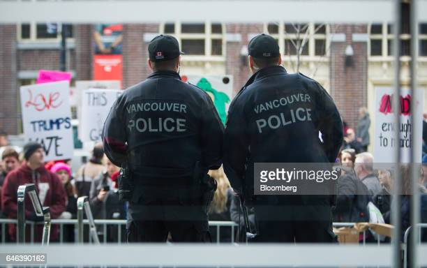 Vancouver Police Department officers stand guard as protesters demonstrate outside the Trump International Hotel Tower during the opening ceremony in...