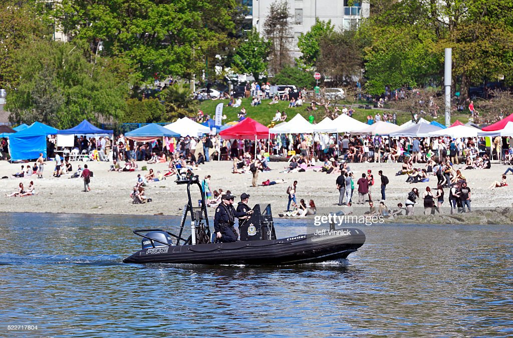 Vancouver police patrol the beach on a boat through False Creek as thousands of people gather at 4/20 celebrations on April 20, 2016 at Sunset Beach in Vancouver, Canada. The Vancouver 4/20 event is the largest free protest festival in the city, with day-long music, public speakers and the world's only open-air public cannabis farmer's market where people sell all kinds of cannabis and extracts while educating the crowd about medical marijuana, political involvement and activism. Canadian Federal Health Minister Jane Philpott says Canada will roll out the legislation in the spring of 2017 to begin the process of legalizing and regulating marijuana.
