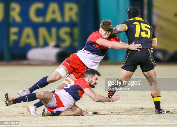 Vancouver Ravens 8man Karl Moran Vancouver Ravens center James Thompson tackle Houston SaberCats fullback Zach Pangelinan during the rugby match...