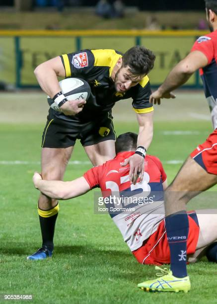 Vancouver Ravens center Cully Quirke brings down Houston SaberCats flyhalf Sam Windsor during the rugby match between the Vancouver Ravens and...
