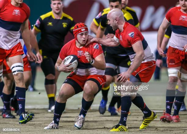 Vancouver Ravens prop Curtis Delmonico gets a pat from Vancouver Ravens flanker Nick Waggot during the rugby match between the Vancouver Ravens and...