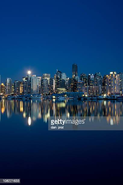 vancouver skyline and reflection on water at dusk - stanley park vancouver canada stock pictures, royalty-free photos & images