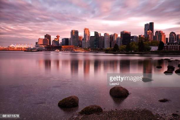 vancouver skyline at sunset, canada - stanley park vancouver canada stock photos and pictures