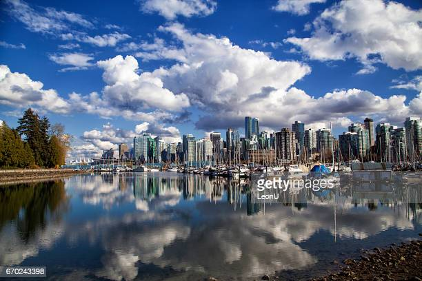 vancouver skyline reflection, canada - vancouver canada stock pictures, royalty-free photos & images