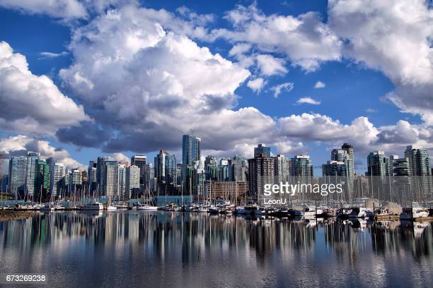 vancouver skyline reflection, canada - stanley park vancouver canada stock photos and pictures