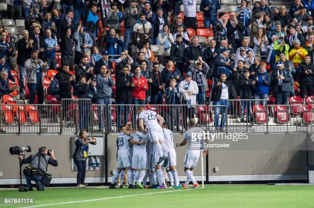 Vancouver Whitecaps celebrate a goal by forward Alphonso Davies in the first half during the CONCACAF Champions League Quarterfinal game between the...