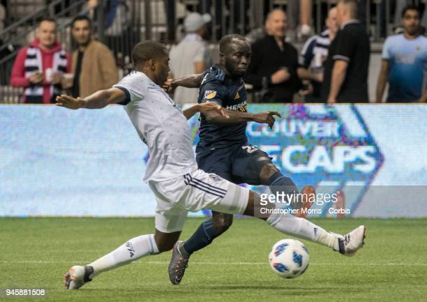 Vancouver Whitecaps defender Aaron Maund and Los Angeles Galaxy midfielder Ema Boateng at BC Place on March 24 2018 in Vancouver Canada