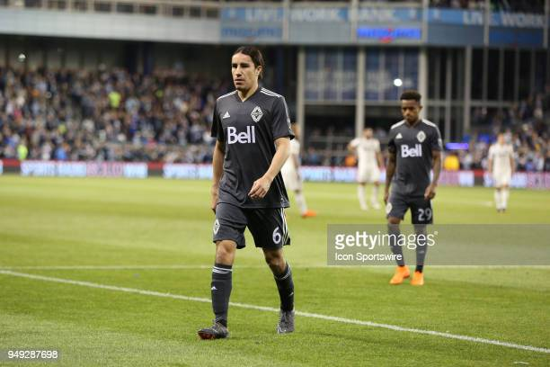 Vancouver Whitecaps defender Efrain Juarez and forward Yordi Reyna walk to the locker after both received red cards in the first half of an MLS match...