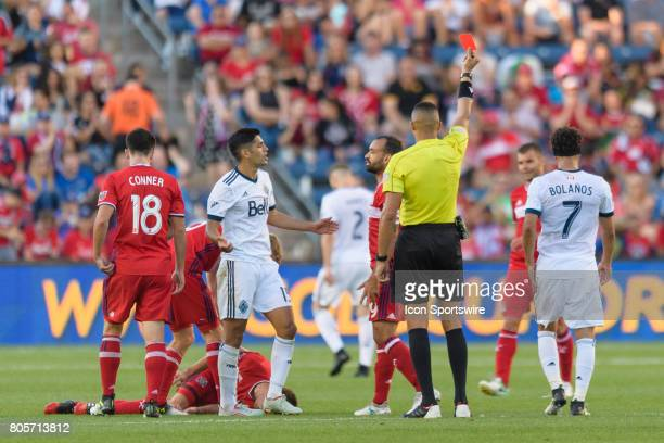 Vancouver Whitecaps FC midfielder Matias Laba receives a red card after fouling Chicago Fire forward Luis Solignac in the second half during an MLS...