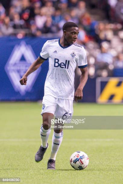 Vancouver Whitecaps forward Alphonso Davies runs with the ball during the game between the Vancouver Whitecaps and the Philadelphia Union at BC Place...