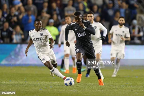 Vancouver Whitecaps forward Bernie IbiniIsei is pursued by Sporting Kansas City midfielder Jimmy Medranda in the second half of an MLS match between...
