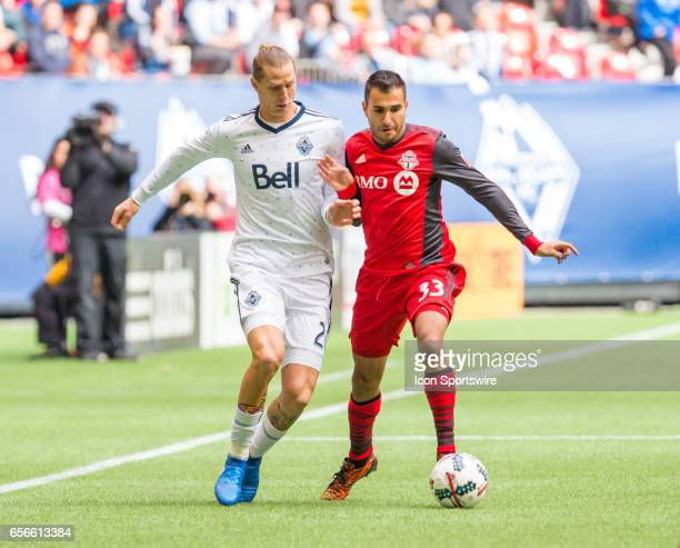 Vancouver Whitecaps midfielder Brek Shea and Toronto FC defender Steven Beitashour battle for the ball during their match at BC Place on March 18...