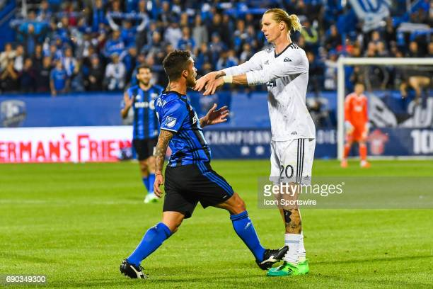 Vancouver Whitecaps midfielder Brek Shea pushing Montreal Impact midfielder Adrian Arregui while arguing with each other during the Montreal Impact...