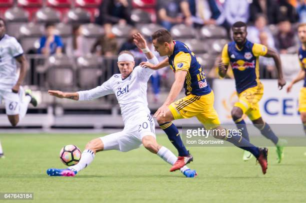 Vancouver Whitecaps midfielder Deybi Flores is upended by New York Red Bulls defender Aaron Long during the CONCACAF Champions League Quarterfinal...