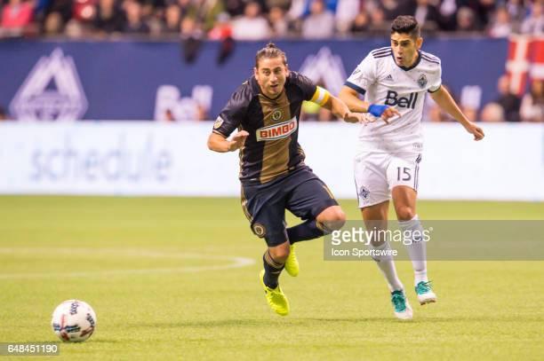 Vancouver Whitecaps midfielder Matias Laba and Philadelphia Union midfielder Alejandro Bedoya battle for position during the game between the...