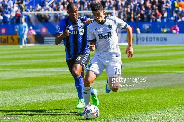 Vancouver Whitecaps midfielder Matias Laba gaining control of the ball while chased by Montreal Impact midfielder Patrice Bernier during the...