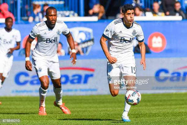 Vancouver Whitecaps midfielder Matias Laba running in control of the ball during the Vancouver Whitecaps FC versus the Montreal Impact game on April...