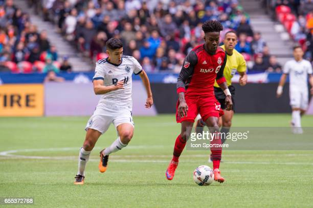 Vancouver Whitecaps midfielder Matias Laba runs after Toronto FC midfielder forward Tosaint Ricketts during their match at BC Place on March 18 2017...