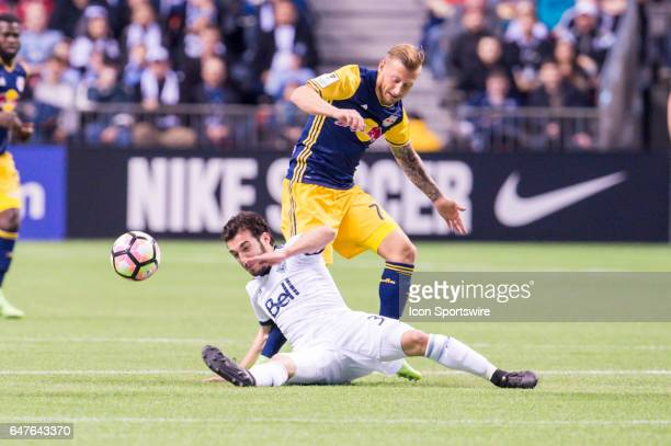 Vancouver Whitecaps midfielder Russell Teibert and New York Red Bulls midfielder Daniel Royer during the CONCACAF Champions League Quarterfinal game...