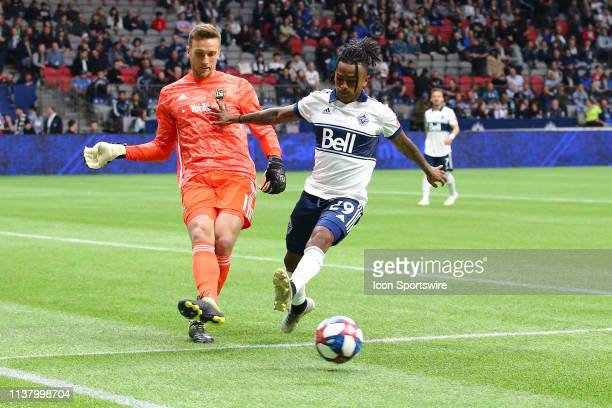Vancouver Whitecaps midfielder/forward Yordy Reyna challenges Los Angeles FC goalkeeper Tyler Miller for the ball during their match at BC Place on...