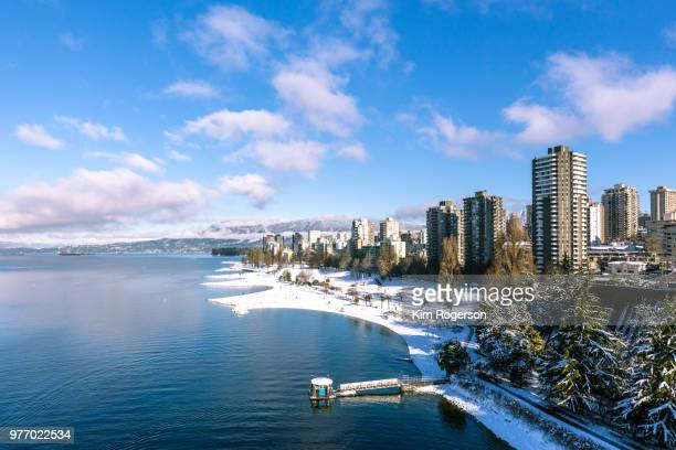 vancouver's english bay & west end apartments with winter snowfall - english bay stock photos and pictures