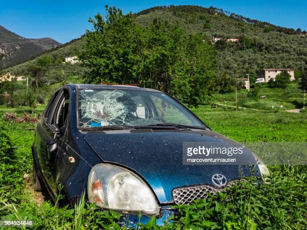 vandalised car in the countryside