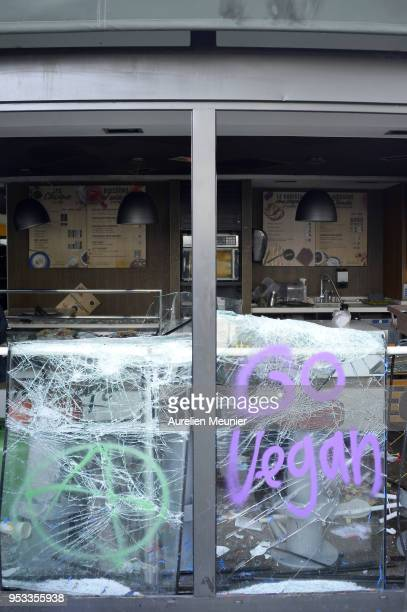 A vandalised food outlet is seen during the May Day demonstration on May 1 2018 in Paris France According to the police around 1200 hooded...
