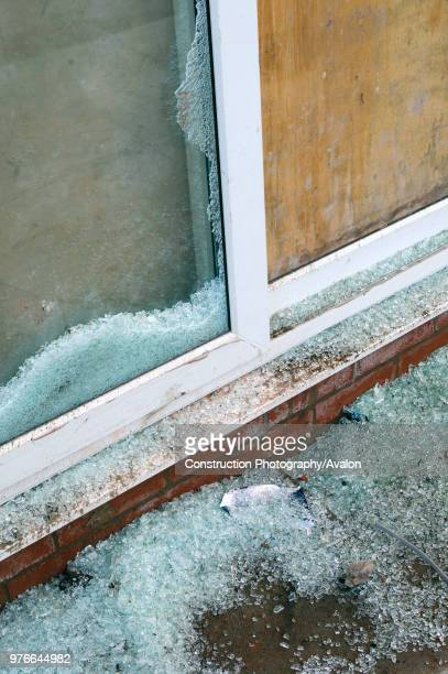 Vandalised French windows on new housing development
