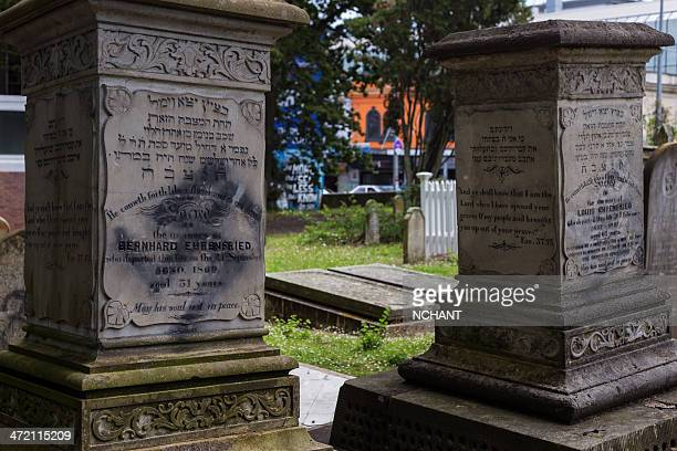 vandalised tomb stones - nazi flag stock pictures, royalty-free photos & images