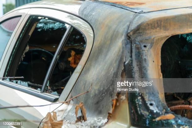 vandalism or revenge, burnt car. car after fire. crime - vandalism stock pictures, royalty-free photos & images