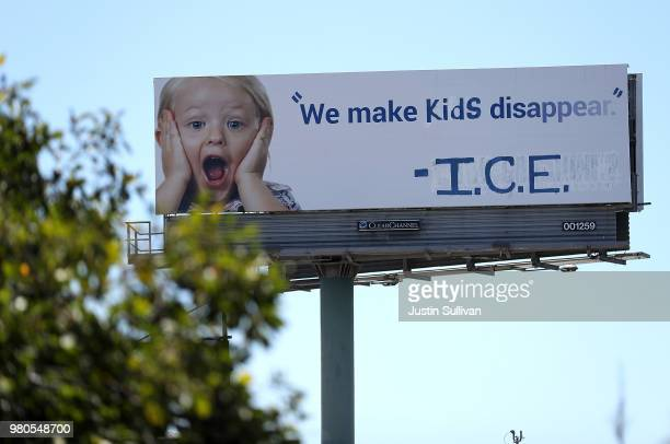 A vandalized 1800GOTJUNK billboard shows a message in in protest with the Immigration and Customs Enforcement and their participation in separating...