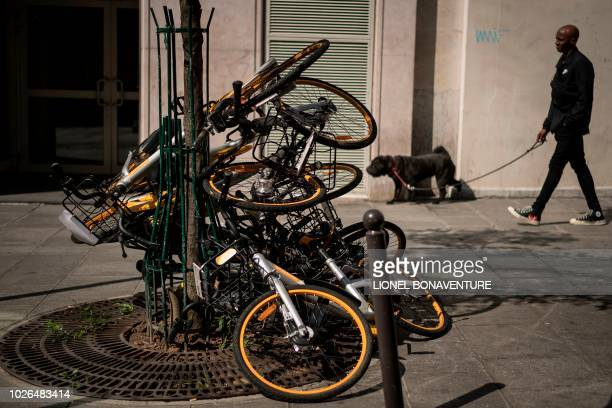 TOPSHOT Vandalized bikes of the oBike dockless bikesharing company are pictured on September 3 2018 in Paris