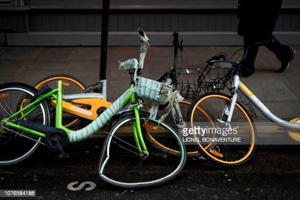 Vandalized bikes of the 'oBike' dockless bikesharing company are pictured on in Paris on January 3 2019