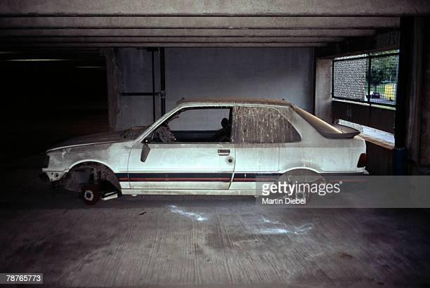 a vandalized car in a parking lot - desaparecidos imagens e fotografias de stock