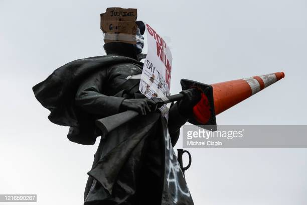 Vandalized Civil War statue looks over the fourth consecutive day of protests in the aftermath of the death of George Floyd on May 31, 2020 in...