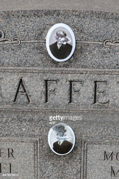 A vandalized grave stone is seen at Stone Road or Waad Hakolel Cemetery in Rochester New York on March 3 2017 Vandals tumbled and defaced headstones...