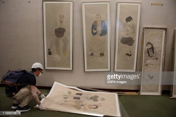 Vandalized paintings inside the legislative council building during the demonstration Hundreds of antigovernment protesters stormed into the...