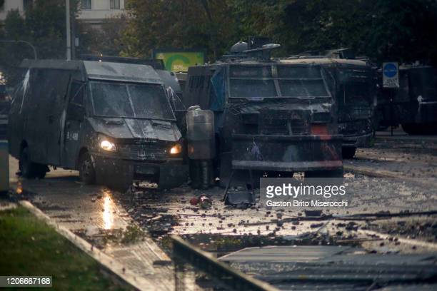 Vandalized riot police vehicles at Alameda Avenue during protests against the government of Sebastián Piñera on its second anniversary on March 11...