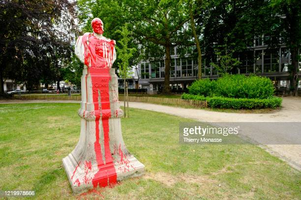 A vandalized statue of the Belgian soldier explorer and official for the Congo Free State General Storms is seen on the Square de Meeus on June 14...