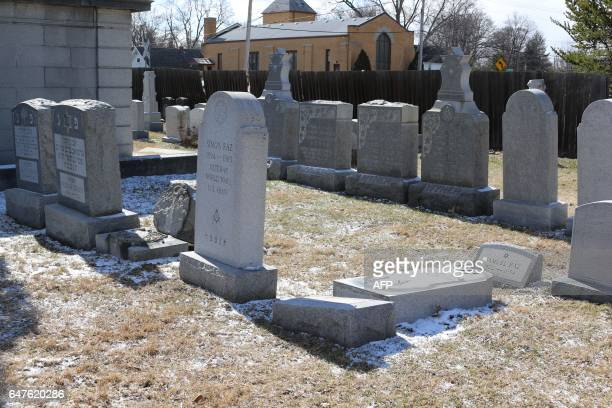 Vandalized stones are scattered at Stone Road or Waad Hakolel Cemetery in Rochester New York on March 3 2017 Vandals tumbled and defaced headstones...