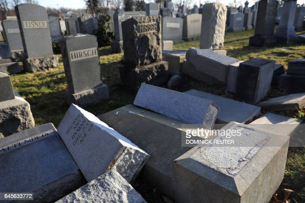 Vandalized tombstones are seen at the Jewish Mount Carmel Cemetery February 26 in Philadelphia PA Police say more than 100 tombstones were vandalized...