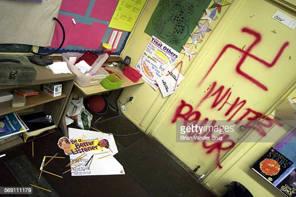 Vandals broke into several classrooms like this one at Erwin Street School over the holiday break scrawling swastikas and racial epithets and...