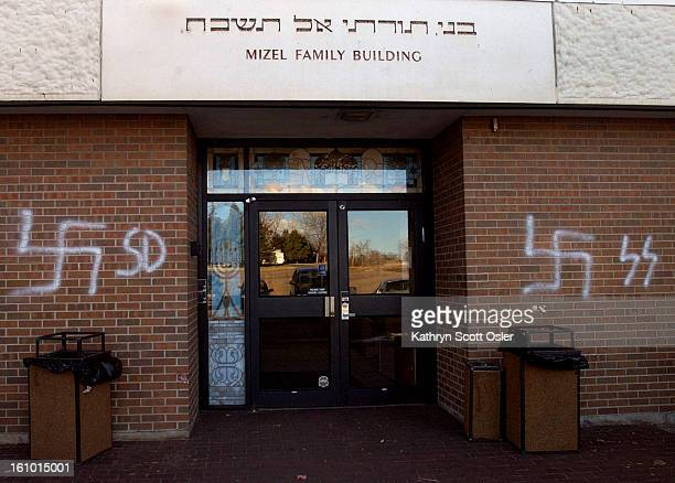 DENVER CO MARCH 6 2004 Vandals used white paint to leave swastikas and other Nazi symbols on the BMHBJ Congregation in Denver