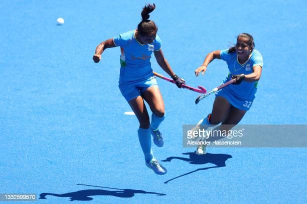 Vandana Katariya of Team India celebrates scoring their third goal with Neha Neha during the Women's Bronze medal match between Great Britain and...