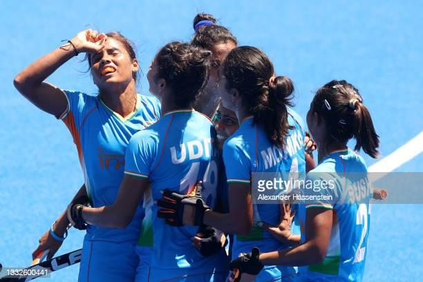 Vandana Katariya of Team India celebrates scoring their third goal with teammates during the Women's Bronze medal match between Great Britain and...