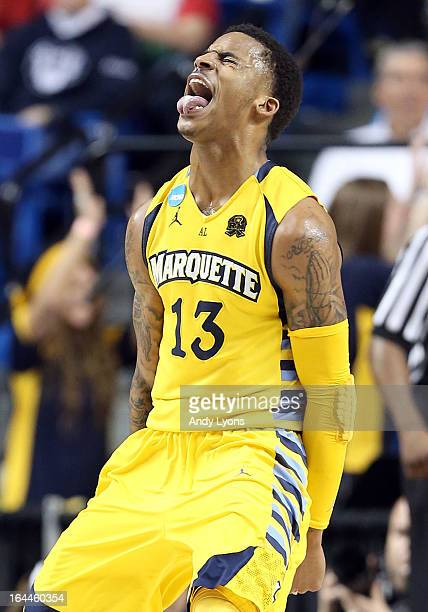 Vander Blue of the Marquette Golden Eagles celebrates during the third round game against the Butler Bulldogs in the 2013 NCAA Men's Basketball...