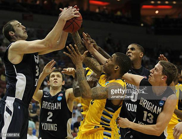 Vander Blue of the Marquette Golden Eagles fights for the rebound against Austin Nelson, Craig Cusick, Brandon Davies and Brock Zylstra of the...
