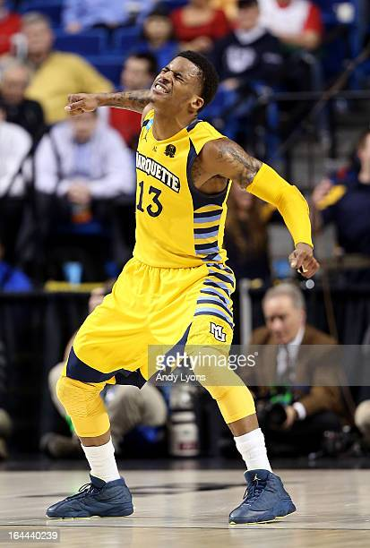 Vander Blue of the Marquette Golden Eagles reacts after a play in the second half against the Butler Bulldogs during the third round of the 2013 NCAA...