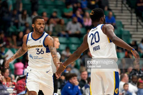 Vander Blue of the Santa Cruz Warriors high fives teammate Jeremy Pargo after a made basket during an NBA GLeague game against the Texas Legends on...